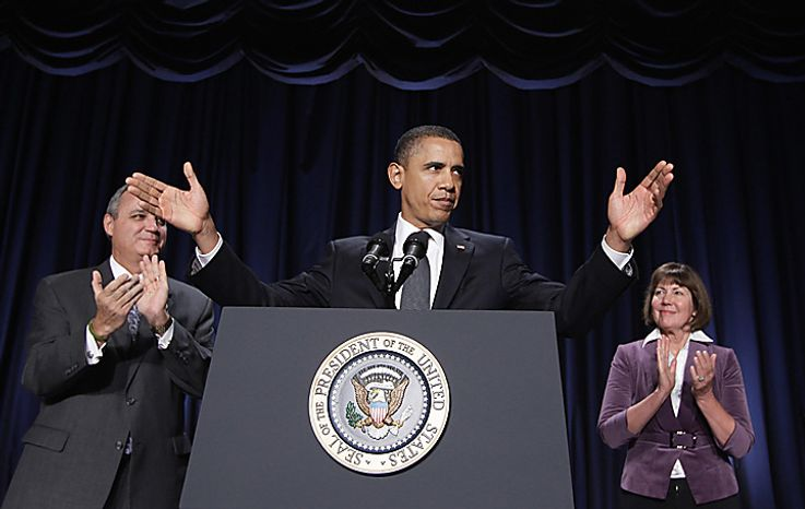 President Obama stands with Rep. Jeff Miller (left), Florida Republican, and Rep. Ann Kirkpatrick, Arizona Democrat, before addressing the National Prayer Breakfast in Washington on Thursday, Feb. 3, 2011. (AP Photo/Charles Dharapak)