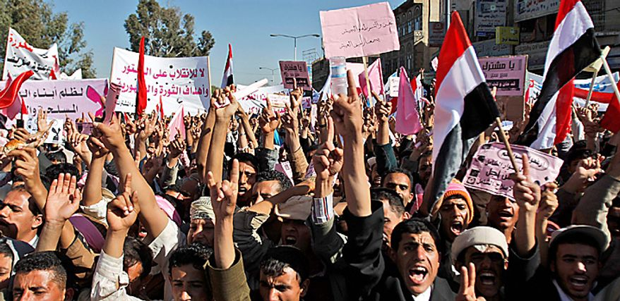 Yemeni demonstrators raise their hands during a demonstration against the government, in Sanaa, Yemen, Thursday, Feb. 3, 2011. Thousands of opponents of Yemen's government and its supporters demonstrated in the capital and other cities a day after the president pledged not to seek another term in office. (AP Photo/Hani Mohammed)