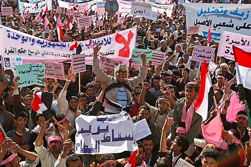 "A Yemeni demonstrator, center, shouts slogans along with others holding banners during a demonstration against the government, in Sanaa, Yemen, Thursday, Feb. 3, 2011. Thousands of opponents of Yemen's government and its supporters demonstrated in the capital and other cities a day after the president pledged not to seek another term in office. Banner on bottom reads in Arabic, "" The people want to break down the system."" (AP Photo/Hani Mohammed)"