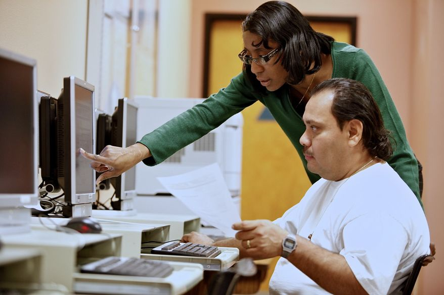 Brigitta Croil, a California state employment program representative, assists job seeker Freddy Gomez in looking for a driver's job at the Verdugo Job Center in Glendale, Calif., on Thursday, Feb. 3, 2011. (AP Photo/Damian Dovarganes)