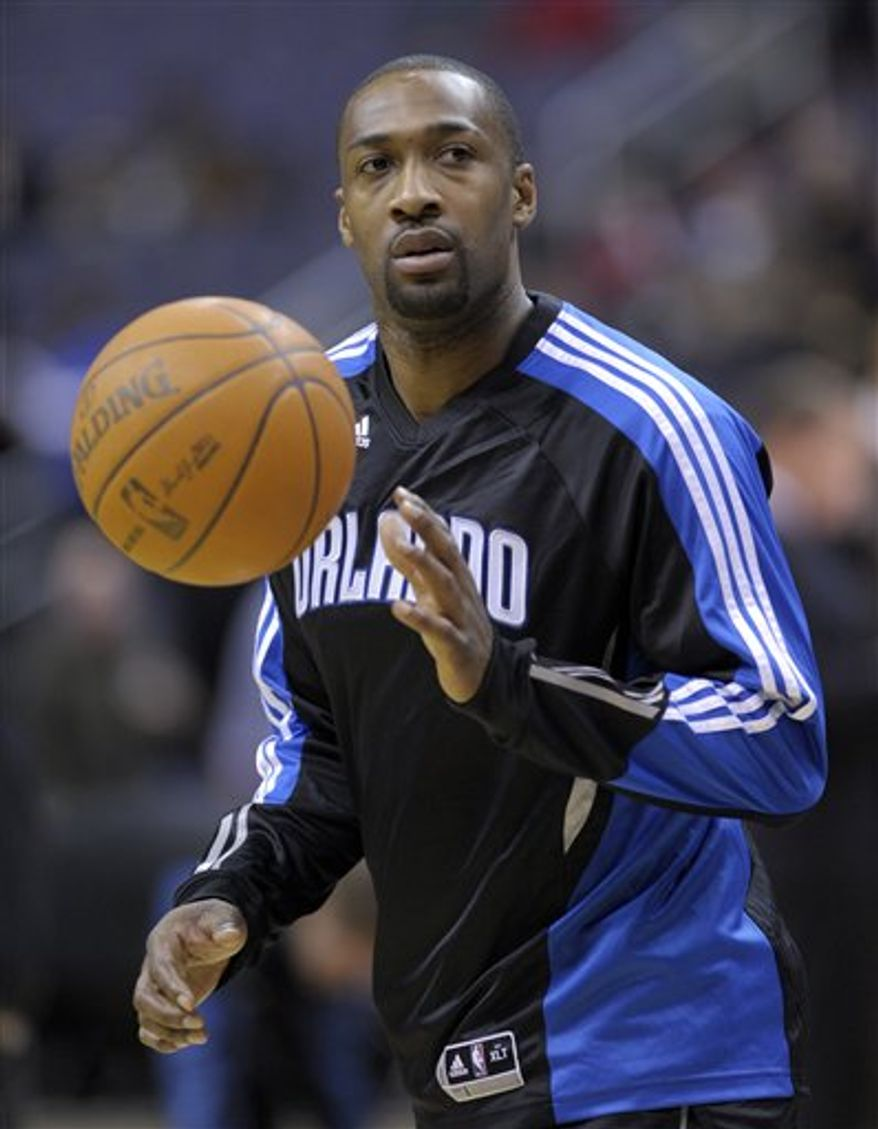 Orlando Magic guard Gilbert Arenas works out before the start of an NBA basketball game against the Washington Wizards at the Verizon Center in Washington, Friday, Feb. 4, 2011. (AP Photo/Susan Walsh)
