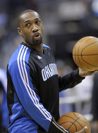 Orlando Magic guard Gilbert Arenas works out before the start of the NBA basketball game against the Washington Wizards at the Verizon Center in Washington, Friday, Feb. 4, 2011. (AP Photo/Susan Walsh)