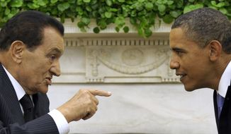 President Obama meets with Egyptian President Hosni Mubarak, left, in the Oval Office of the White House in Washington on Sept. 1, 2010. U.S. intelligence agencies' failure to predict the uprisings in Tunisia and Egypt had drawn criticism from the White House and Congress. (AP Photo/Susan Walsh, File)
