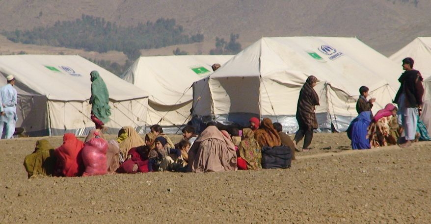 Pakistani displaced people arrive at a camp set up in Naghi, 11 miles northwest of the Afghanistan border in the Pakistani tribal area of Mohmand on Jan. 31, 2011. About 22,000 Pakistani villagers have fled military operations against Islamist militants in a tribal region near the Afghan border, a government administrator and the army said on Friday, Feb. 4, 2011. (AP Photo/Anwarullah Khan)