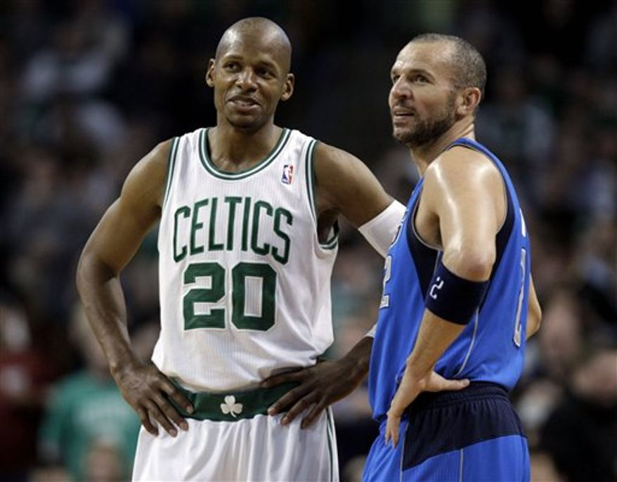 Boston Celtics guard Ray Allen (20) and Dallas Mavericks guard Jason Kidd (2) talk during a lull in the action in the second half of their NBA basketball game at the Garden in Boston, Friday, Feb. 4, 2011. The Mavericks defeated the Celtics 101-97. Kidd made a 3-pointer with 2.5 seconds left for the win. (AP Photo/Stephan Savoia)