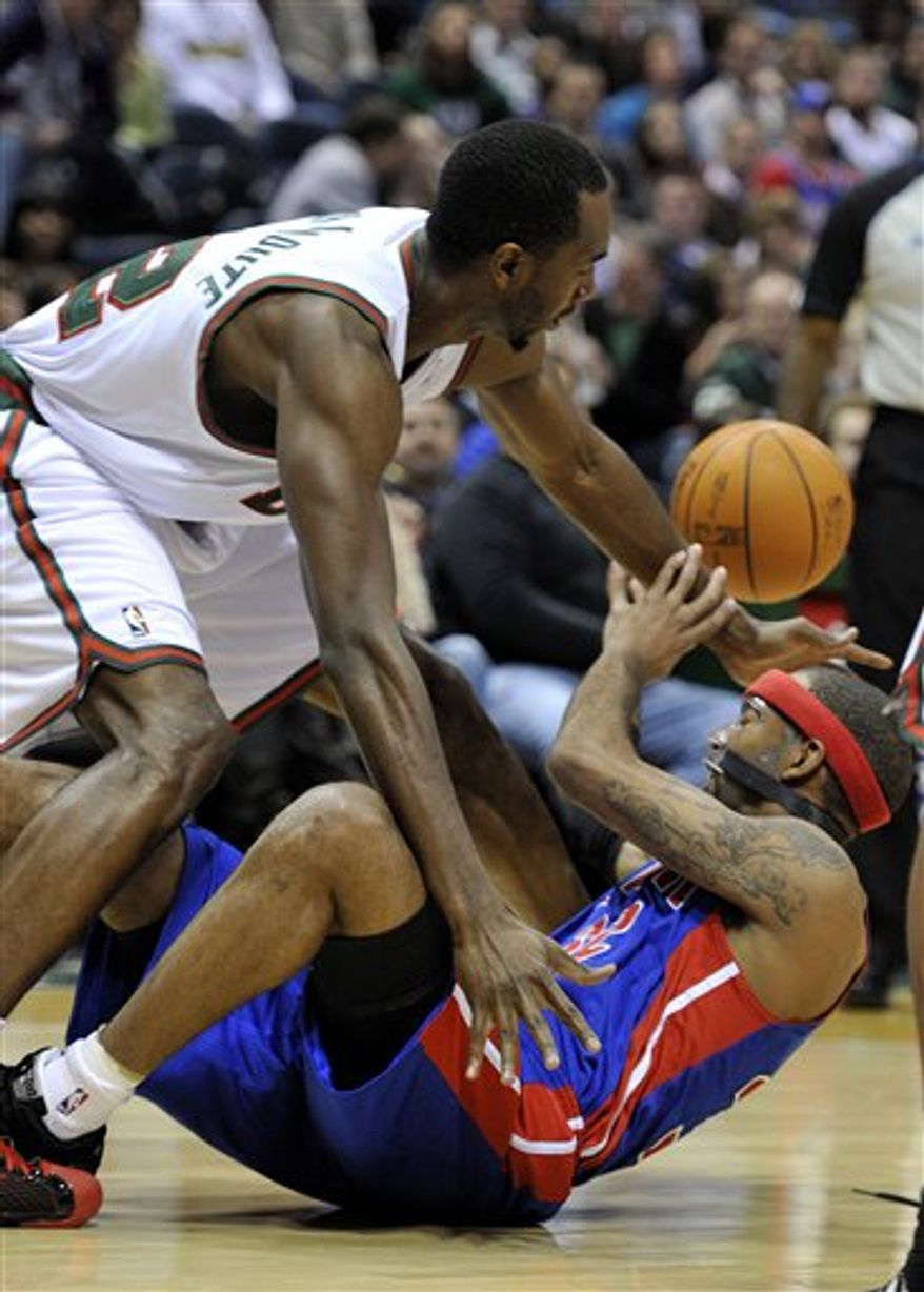 Milwaukee Bucks' John Salmons, left, defends as Detroit Pistons' Richard Hamilton (32) shoots during the first half of an NBA basketball game, Saturday, Feb. 5, 2011, in Milwaukee. (AP Photo/Jim Prisching)