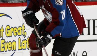 FILE - In this April 28, 2008, file photo, Colorado Avalanche center Peter Forsberg from Sweden, looks to pass against the Detroit Red Wings during the second period of Game 3 in the Western Conference semifinal hockey game in Denver. (AP Photo/Jack Dempsey, File)
