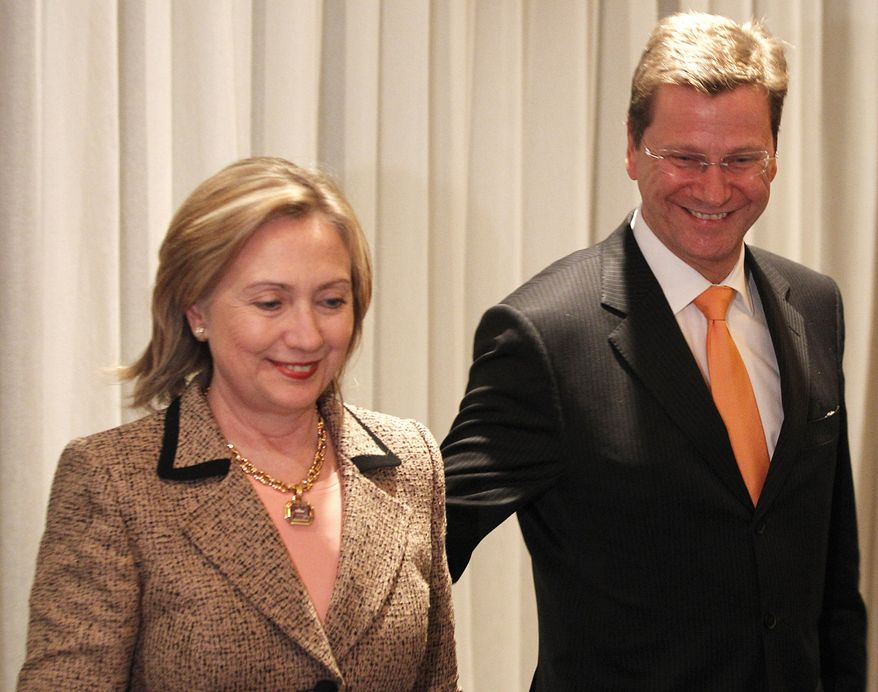 U.S. Secretary of State Hillary Rodham Clinton meets German Foreign Minister Guido Westerwelle during the Conference on Security Policy in Munich on Saturday, Feb. 5, 2011. (AP Photo/Frank Augstein)