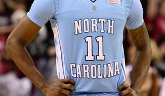 FILE - In this Jan. 4, 2010, file photo, North Carolina's Larry Drew II reacts after the College of Charleston defeated North Carolina in overtime during an NCAA college basketball game in Charleston, S.C. Drew has left the Tar Heels program, a person familiar with the situation told The Associated Press on Friday. (AP Photo/Mic Smith, File)