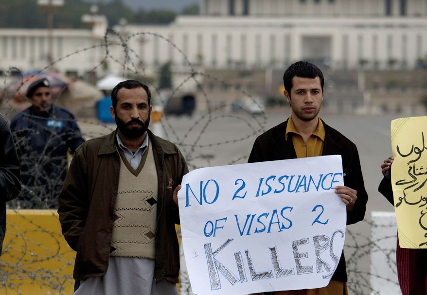 Pakistanis demonstrate in front of the presidential residence in Islamabad, Pakistan, on Friday, Feb. 4, 2011, to condemn a U.S. Embassy employee suspected in a shooting incident that killed two Pakistanis. (AP Photo/B.K. Bangash)