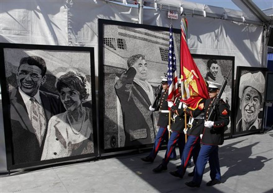 Former first lady Nancy Reagan is helped by Marine Lt. Gen. George J. Flynn after a wreath laying ceremony for her husband former U.S. President Ronald Reagan during the centennial birthday celebration at the Ronald Reagan Presidential Library, in Simi Valley, Calif, on Sunday Feb. 6,2011. (AP Photo/Richard Vogel)