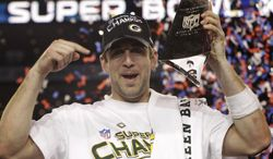 Green Bay Packers' Aaron Rodgers holds the Vince Lombardi Trophy while celebrating the Packers' 31-25 win against the Pittsburgh Steelers in the NFL football Super Bowl XLV game on Sunday, Feb. 6, 2011, in Arlington, Texas. (AP Photo/David J. Phillip)
