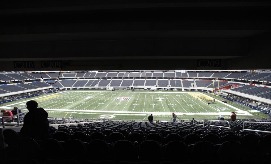 Work continues at Cowboys Stadium on Thursday, Jan. 27, 2011--as seen from additional seating--in preparation for NFL football's Super Bowl XLV between the Green Bay Packers and the Pittsburgh Steelers on Feb. 6. Fans in the seats would not be able to see the video board that is installed above the field. (AP Photo/The Dallas Morning News, Michael Ainsworth)