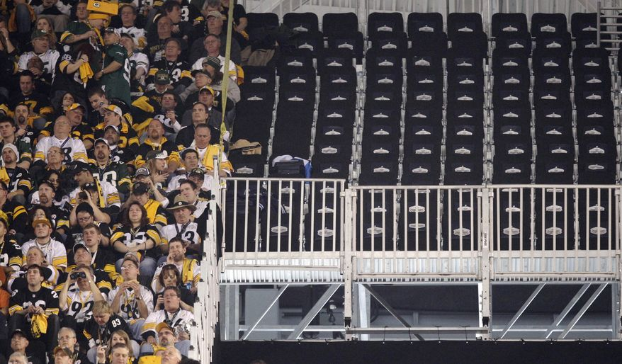 A section of empty seats are seen at Cowboys Stadium before the NFL football Super Bowl XLV game between the Green Bay Packers and the Pittsburgh Steelers Sunday, Feb. 6, 2011, in Arlington, Texas. The seats were deemed unsafe before the game. (AP Photo/Chris O'Meara)