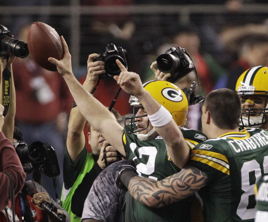 Green Bay Packers' Aaron Rodgers (12) reacts after the NFL Super Bowl XLV football game against Pittsburgh Steelers, Sunday, Feb. 6, 2011, in Arlington, Texas. Green Bay won 31-25. (AP Photo/Kathy Willens)