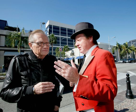 "Former CNN host Larry King chats with Mr. Donovan on Rodeo Drive and expresses astonishment at his dismissal by the Beverly Hills Conference & Visitors Bureau. ""How could they do that?"" he said. ""He's a Beverly Hills institution."" (Associated Press)"