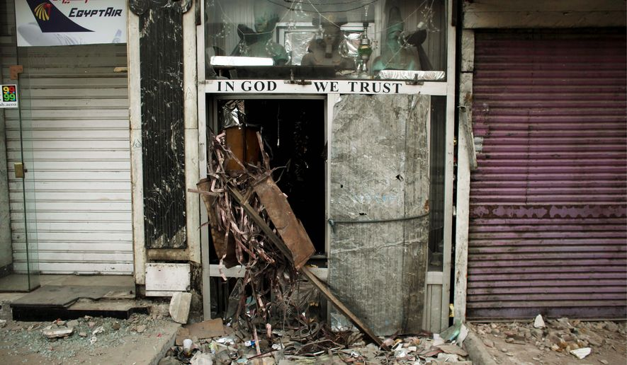 A vandalized souvenir shop near Tahrir Square in Cairo gives only a small indication of the big economic fallout from the continuing anti-government protests in Egypt. (Associated Press)