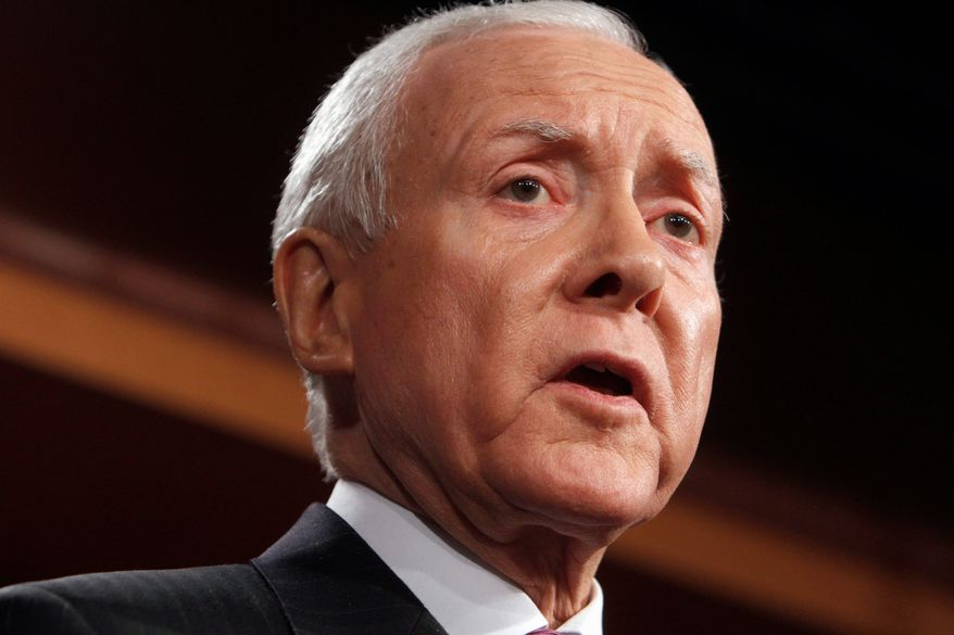 Sen. Orrin G. Hatch says lawmakers should end special individual and corporate tax breaks but not to put money back into the federal government. (Associated Press)