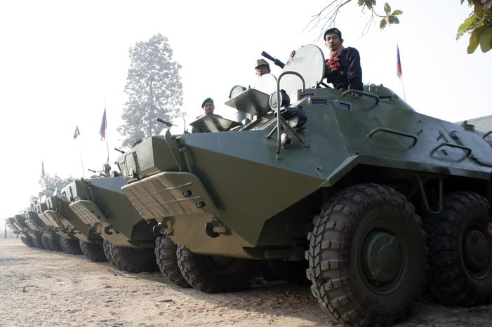 In this photo released by China's Xinhua news agency, Cambodian armed vehicles stand by Sunday in Preah Vihear province, 300 miles northwest of Phnom Penh, Cambodia. (Associated Press/Xinhua)