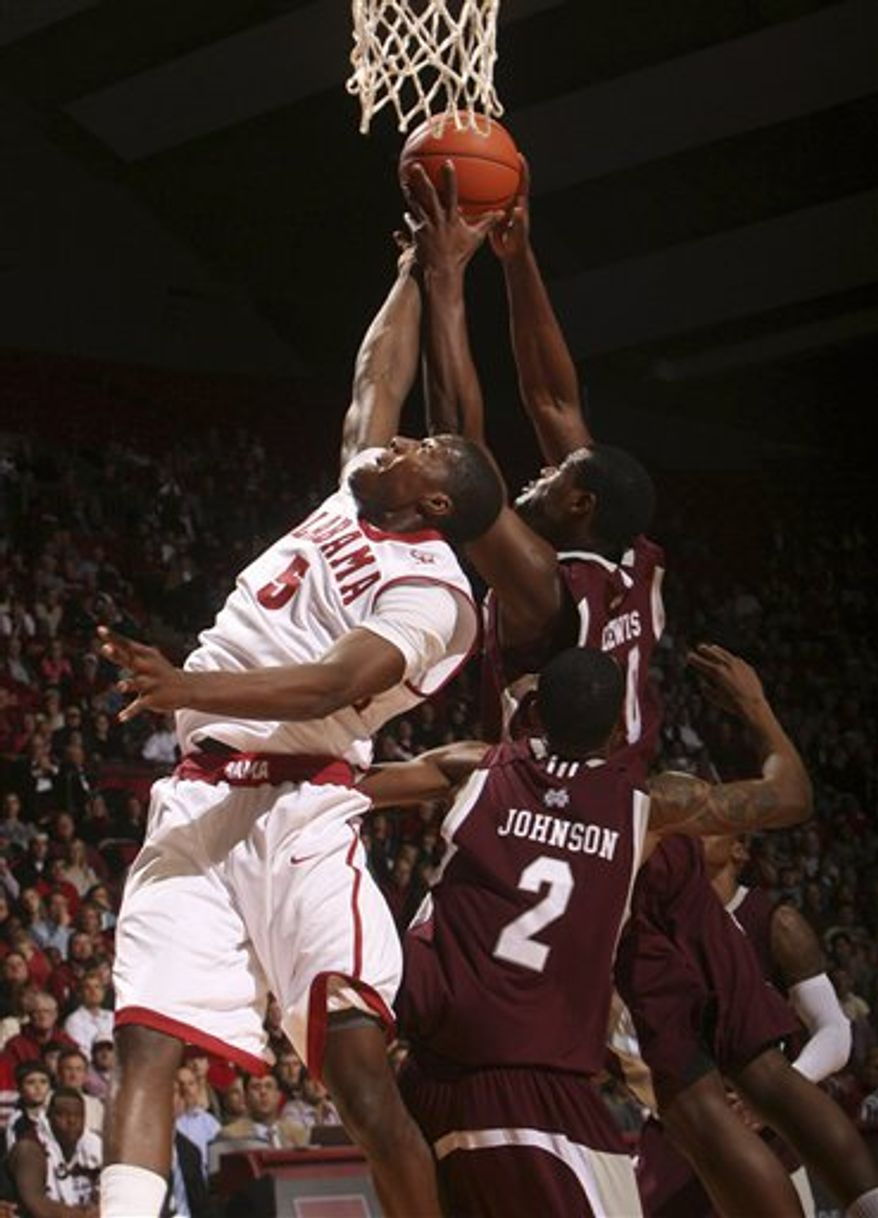 Alabama forward Tony Mitchell (5) reaches for a rebound against Mississippi State's Ravern Johnson (2) and Wendell Lewis (30) during the first half of an NCAA college basketball game at Coleman Coliseum in Tuscaloosa, Ala., on Wednesday, Feb. 2, 2011. (AP Photo/Tuscaloosa News, Robert Sutton)