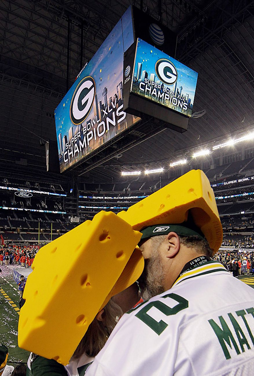 Fans of the Green Bay Packers celebrate after the Packers beat the Pittsburgh Steelers 31-25 in the NFL Super Bowl XLV football game on Sunday, Feb. 6, 2011, in Arlington, Texas. (AP Photo/Patrick Semansky)