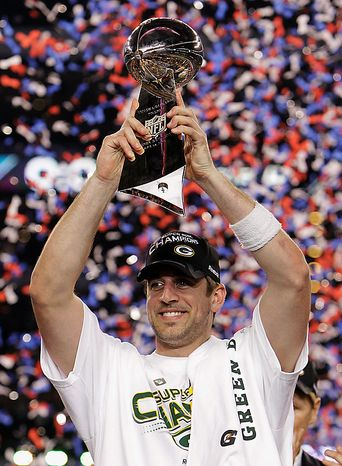 Green Bay Packers' Aaron Rodgers holds the Vince Lombardi Trophy after the Packers' 31-25 win over the Pittsburgh Steelers in the NFL Super Bowl XLV football game on Sunday, Feb. 6, 2011, in Arlington, Texas. Rodgers was named most valuable player of the game. (AP Photo/Mark Humphrey)