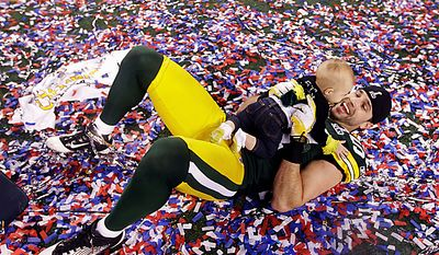 The Green Bay Packers' Matt Wilhelm celebrates with his daughter Tianna after beating the Pittsburgh Steelers 31-25 in the NFL football Super Bowl XLV game on Sunday, Feb. 6, 2011, in Arlington, Texas. (AP Photo/David J. Phillip)