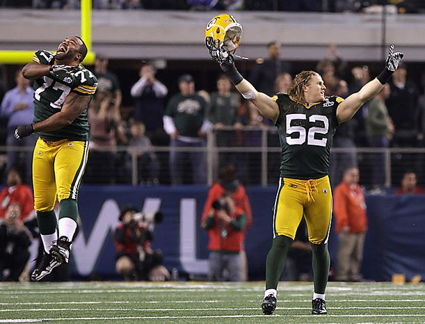 The Green Bay Packers' Cullen Jenkins, left, and Clay Matthews (52) celebrate after beating the Pittsburgh Steelers 31-25 in the NFL football Super Bowl XLV game on Sunday, Feb. 6, 2011, in Arlington, Texas. (AP Photo/Matt Slocum)