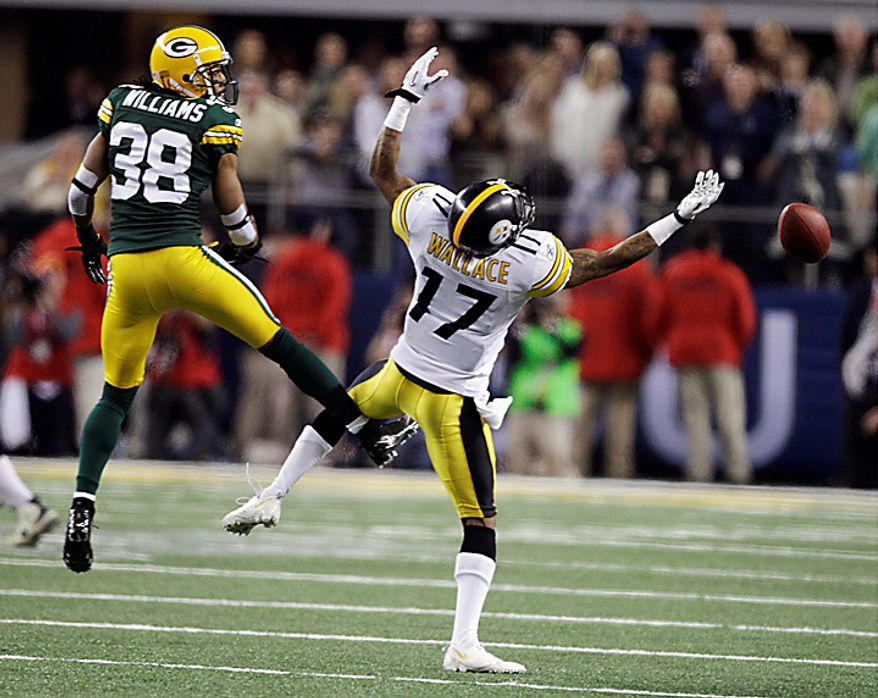 The Pittsburgh Steelers' Mike Wallace fails to catch a pass on fourth down of the Steelers' last possession as the Green Bay Packers' Tramon Williams looks on in the second half of  the NFL Super Bowl XLV football game on Sunday, Feb. 6, 2011, in Arlington, Texas. The Steelers lost the game 31-25. (AP Photo/Charlie Krupa)