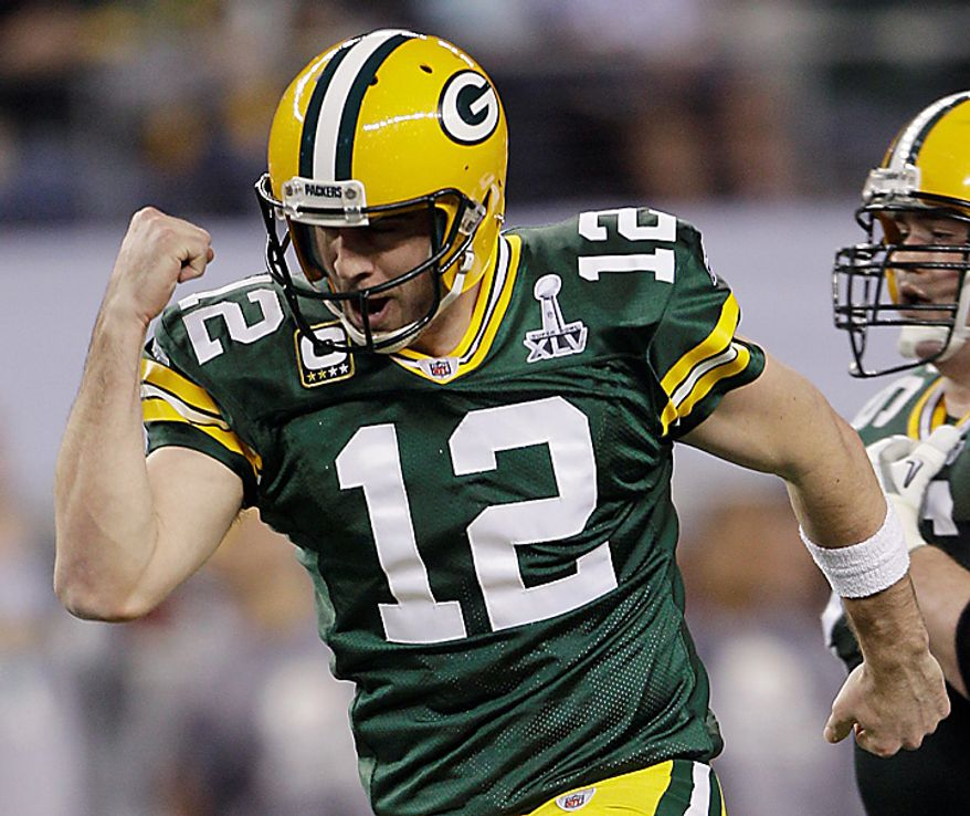 The Green Bay Packers' Aaron Rodgers pumps his fist as he celebrates after Jordy Nelson scored a touchdown during the first half of the NFL football Super Bowl XLV game with the Pittsburgh Steelers on Sunday, Feb. 6, 2011, in Arlington, Texas. (AP Photo/Paul Sancya)