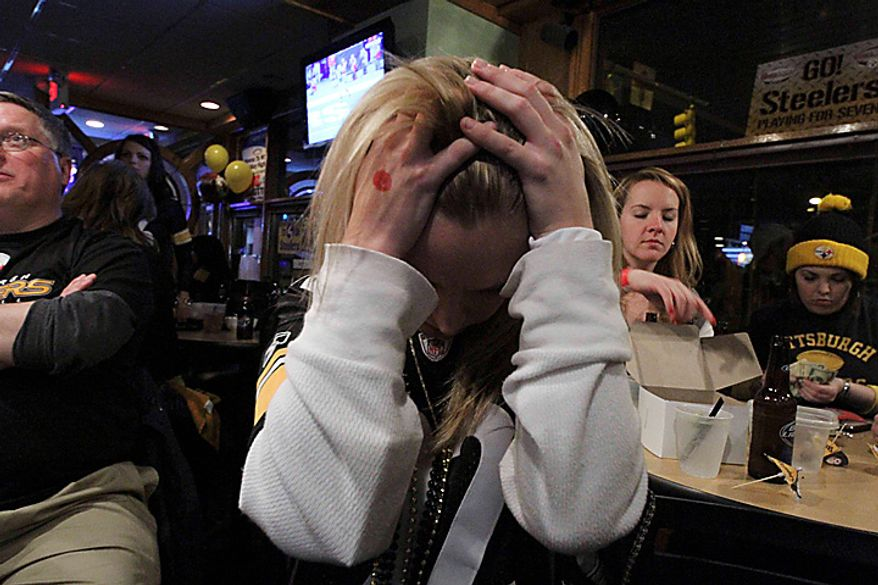 Pittsburgh Steelers fan Jennifer Mathews of Pittsburgh reacts to a fourth-quarter touchdown by the Green Bay Packers on Sunday, Feb. 6, 2011, in a bar on the Southside of Pittsburgh. The Packers defeated the Steelers 31-25 in the NFL's Super Bowl XLV football game. (AP Photo/Gene J. Puskar)