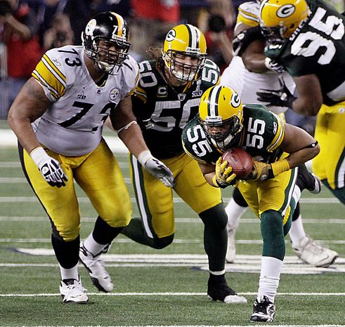 The Green Bay Packers' Desmond Bishop (55) recovers a fumble by the Pittsburgh Steelers' Rashard Mendenhall during the second half of the NFL Super Bowl XLV football game on Sunday, Feb. 6, 2011, in Arlington, Texas. Watching the play are the Steelers' Ramon Foster (7