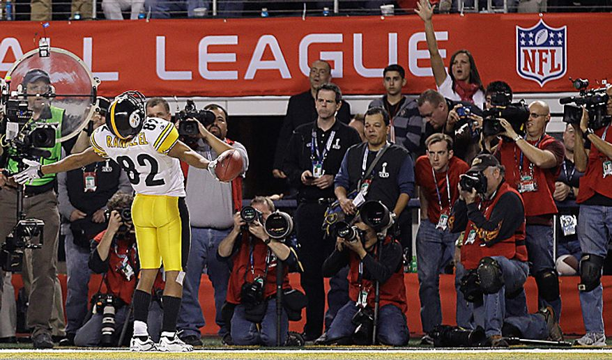 The Pittsburgh Steelers' Antwaan Randle El celebrates after scoring a 2-point conversion against the Green Bay Packers during the second half of the NFL football Super Bowl XLV game on Sunday, Feb. 6, 2011, in Arlington, Texas. (AP Photo/Matt Slocum)