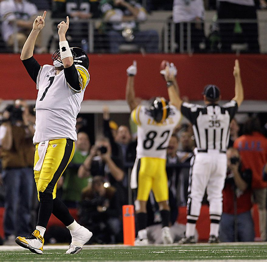 The Pittsburgh Steelers' Ben Roethlisberger, left, celebrates after his team scored a 2-point conversion against the Green Bay Packers during the second half of the NFL football Super Bowl XLV game on Sunday, Feb. 6, 2011, in Arlington, Texas. (AP Photo/Paul Sancya)