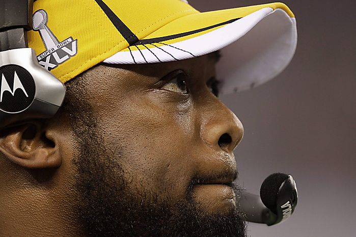 Pittsburgh Steelers head coach Mike Tomlin looks on during the second half of the NFL Super Bowl XLV football game against the Green Bay Packers on Sunday, Feb. 6, 2011, in Arlington, Texas. (AP Photo/Charlie Krupa)