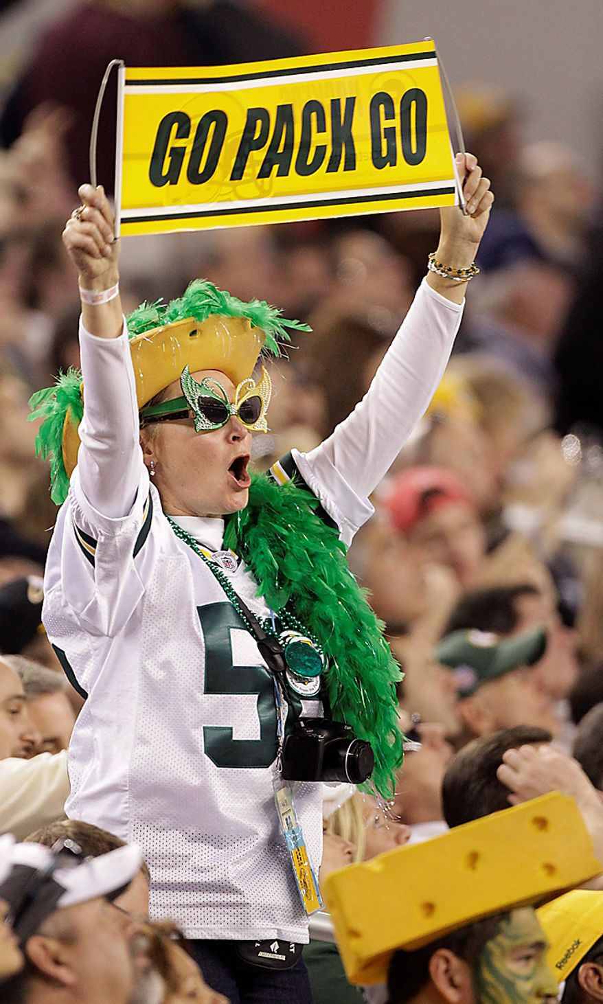 A Green Bay Packers fan watches the action during the first half of the NFL Super Bowl XLV football game between the Packers and the Pittsburgh Steelers on Sunday, Feb. 6, 2011, in Arlington, Texas. (AP Photo/Kathy Willens)