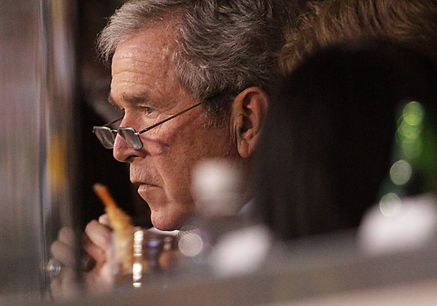 Former President George W. Bush watches the first half of the NFL Super Bowl XLV game between the Green Bay Packers and the Pittsburgh Steelers on Sunday, Feb. 6, 2011, in Arlington, Texas. (AP Photo/LM Otero)