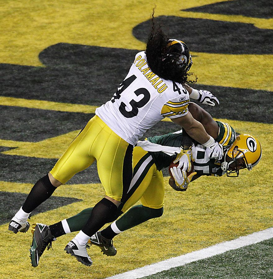The Pittsburgh Steelers' Troy Polamalu (43) delivers a blow to the Green Bay Packers' Greg Jennings as Jennings makes a reception for a touchdown during the first half of the NFL Super Bowl XLV football game on Sunday, Feb. 6, 2011, in Arlington, Texas. (AP Photo/Charlie Riedel)
