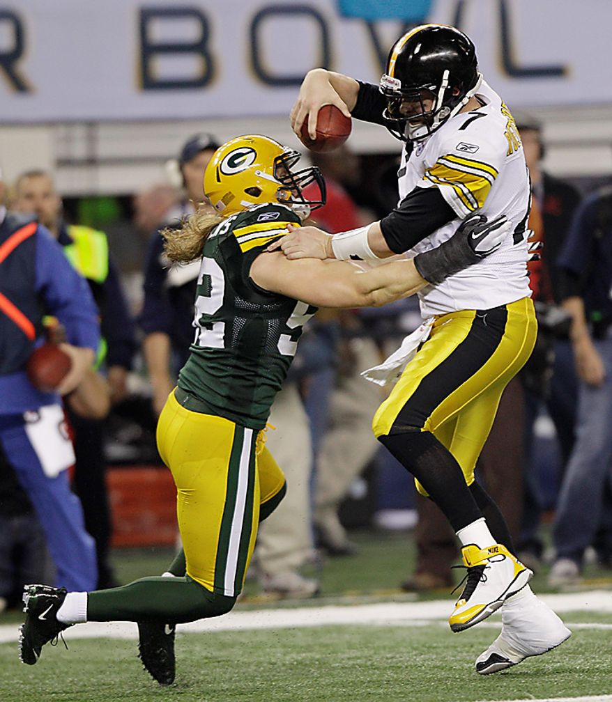 The Pittsburgh Steelers' Ben Roethlisberger, right, is sacked by the Green Bay Packers' Clay Matthews during the first half of the NFL Super Bowl XLV game on Sunday, Feb. 6, 2011, in Arlington, Texas. (AP Photo/David J. Phillip)