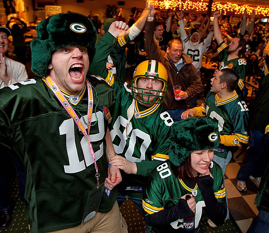 Green Bay Packers fans celebrate on Sunday, Feb. 6, 2011, at the Stadium View Bar near Lambeau Field in Green Bay, Wis., after the Packers won Super Bowl XLV. (AP Photo/Mike Roemer)