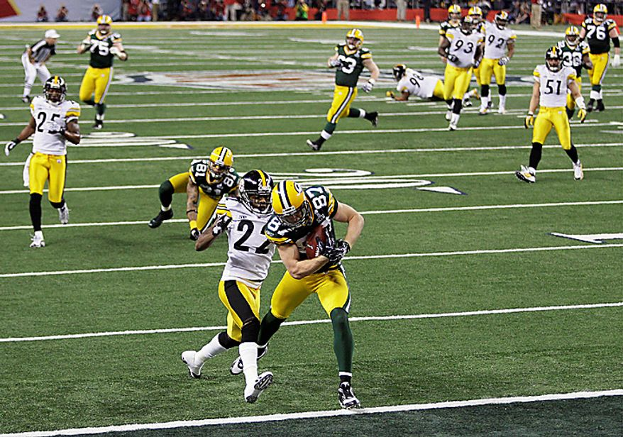 The Green Bay Packers' Jordy Nelson (87) catches the ball for a touchdown against the Pittsburgh Steelers' William Gay (22) in the first half of NFL Super Bowl XLV football game on Sunday, Feb. 6, 2011, in Arlington, Texas. (AP Photo/Patrick Semansky)