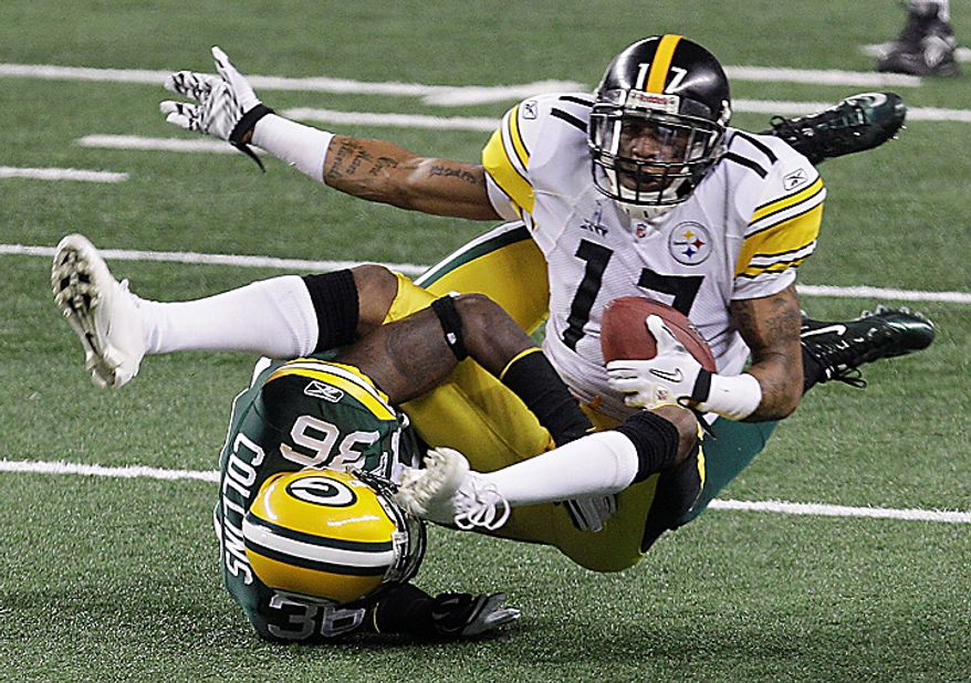 The Pittsburgh Steelers' Mike Wallace (17) is tackled by the Green Bay Packers' Nick Collins (36) during the first half of the NFL Super Bowl XLV football game on Sunday, Feb. 6, 2011, in Arlington, Texas. (AP Photo/Marcio Jose Sanchez)