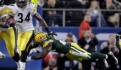 The Pittsburgh Steelers' Rashard Mendenhall (34) tries to break a tackle by the Green Bay Packers' Charlie Peprah during the first quarter of the NFL Super Bowl XLV game on Sunday, Feb. 6, 2011, in Arlington, Texas. (AP Photo/Matt Slocum)