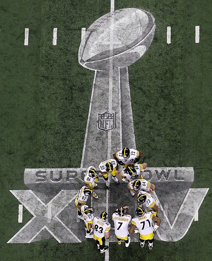 The Pittsburgh Steelers huddle up during the first half of the NFL Super Bowl XLV football game against the Green Bay Packers on Sunday, Feb. 6, 2011, in Arlington, Texas. (AP Photo/Matt Slocum)