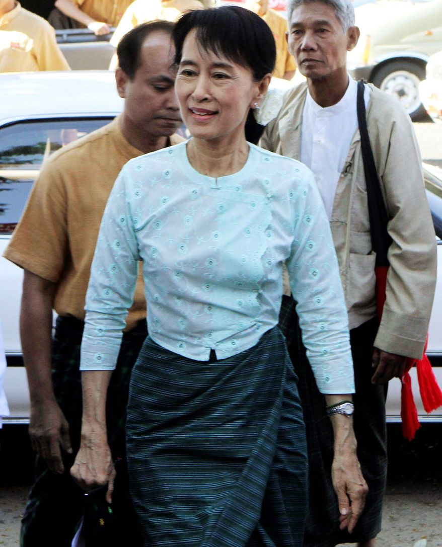 Pro-democracy leader Aung San Suu Kyi and her party say Western sanctions against Myanmar hurt the military junta, not the people, and should continue. (Associated Press)