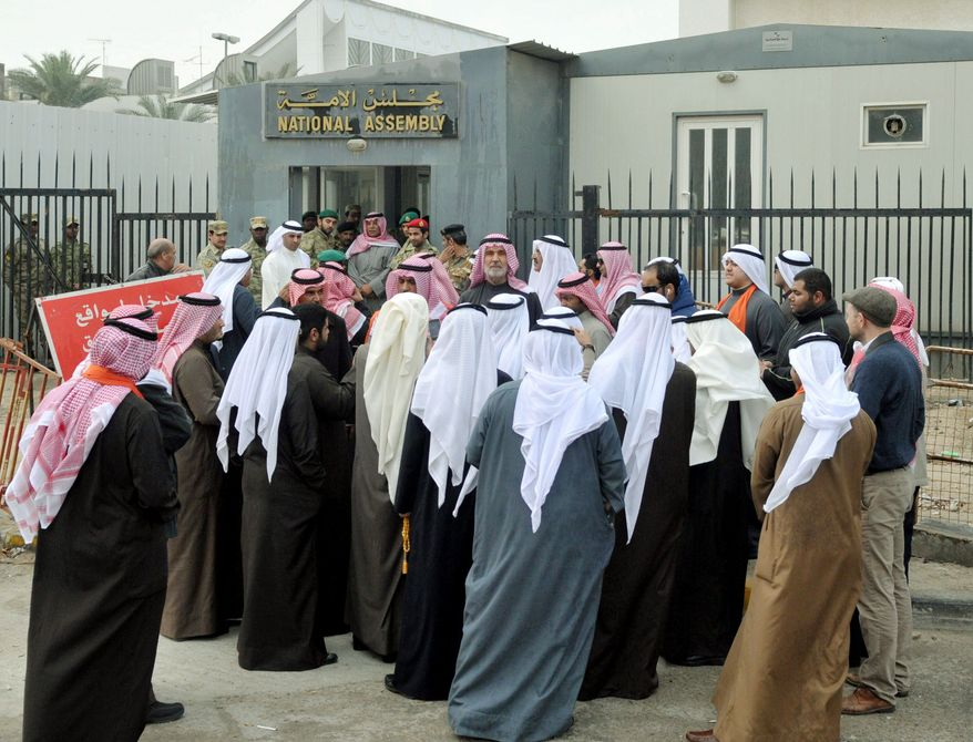 Kuwaitis gather Tuesday outside parliament to demand a change of government. Kuwait is a leader among Gulf states in having a parliament that can challenge ruling authority. Nevertheless, calls have gone out on social-media sites for protests next month in Kuwait. (Associated Press)