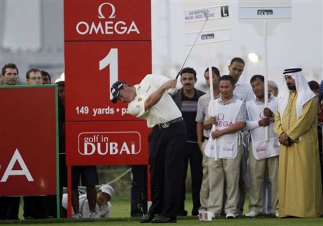 Tiger Woods tees off on the 2nd hole during the Pro-Am at the Emirates Golf Club a day ahead of Dubai Desert Classic golf tournament in Dubai, United Arab Emirates, Wednesday Feb. 9, 2011. (AP Ph