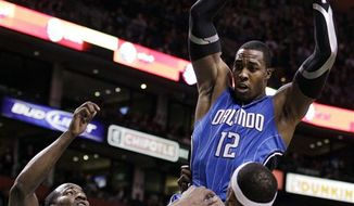 Orlando Magic center Dwight Howard grimaces as he heads to the bench after being hit in the face during play by Boston Celtics center Semih Erden in the first half of an NBA basketball game in Boston on Sunday, Feb. 6, 2011. (AP Photo/Elise Amendola)
