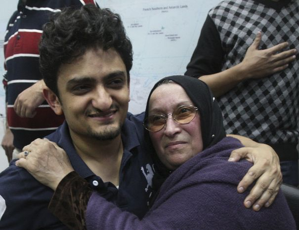 Egyptian Wael Ghonim, a Google Inc. marketing manager who became a hero of the demonstrators since he went missing on Jan. 27, hugs the mother of Khaled Said, a 28-year-old businessman who died in June 2010 at the hands of undercover police, on Tuesday at Tahrir Square in Cairo. (Associated Press)