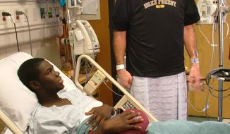 In this provided by Wake Forest University, Wake Forest baseball coach Tom Walter, right, visits with player Kevin Jordan one day after donating a kidney to Jordan at Emory University Hospital in Atlanta on Tuesday, Feb. 8, 2011. Jordan was diagnosed last April with ANCA vasculitis, a type of autoimmune swelling disorder caused by abnormal antibodies. (AP Photo/Wake Forest University, Steve Shutt)